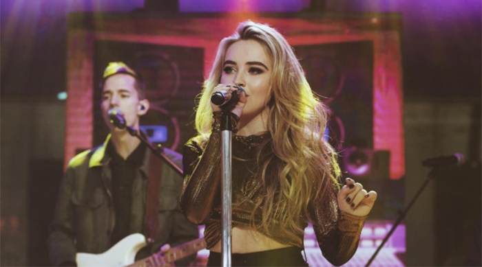 Sabrina Carpenter singing on stage