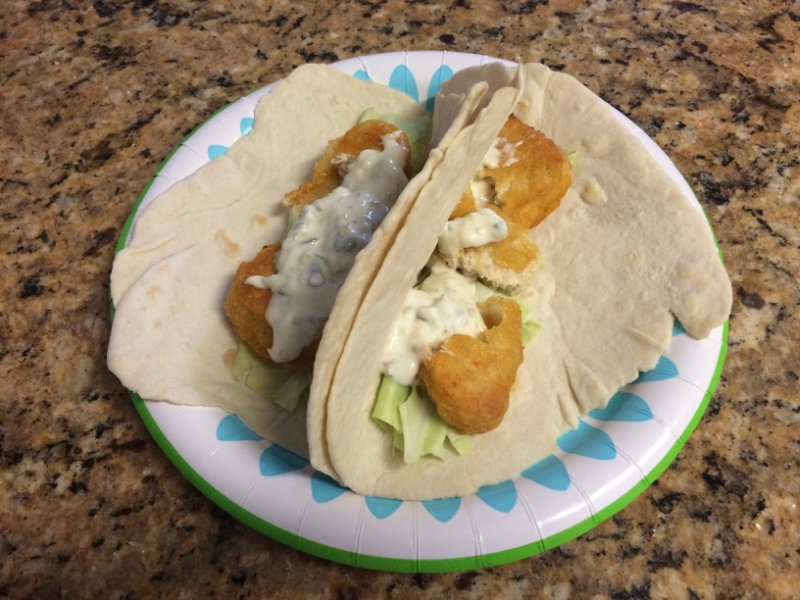 Vegan fish tacos on a paper plate