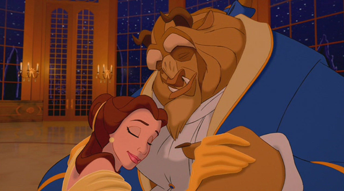 The Beast and Belle hugging on the dance floor