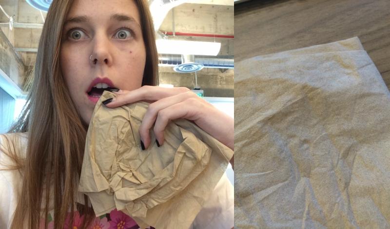 Girl dabbing lips with napkin
