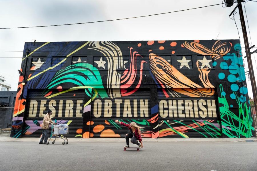 "Graffiti wall with the words ""Desire, Obtain, Cherish"""