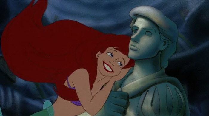 Ariel gazing at Prince Eric's statue