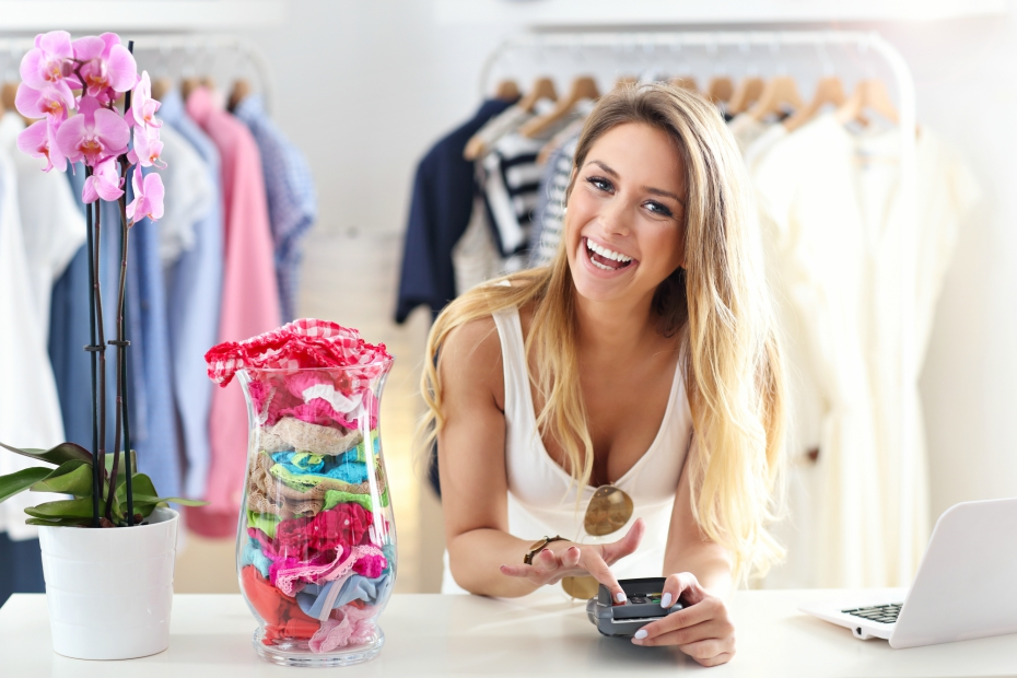 cute girl smiles while working at her boutique