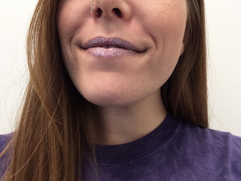 Purple glitter on girl's lips