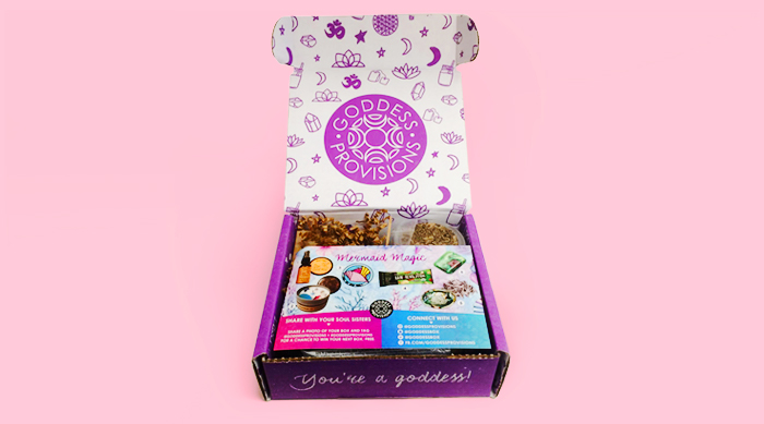 Goddess Provisions subscription box on a pink background
