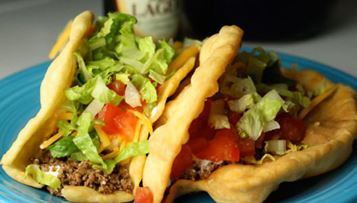 Two homemade Taco Bell Chalupas on a plate