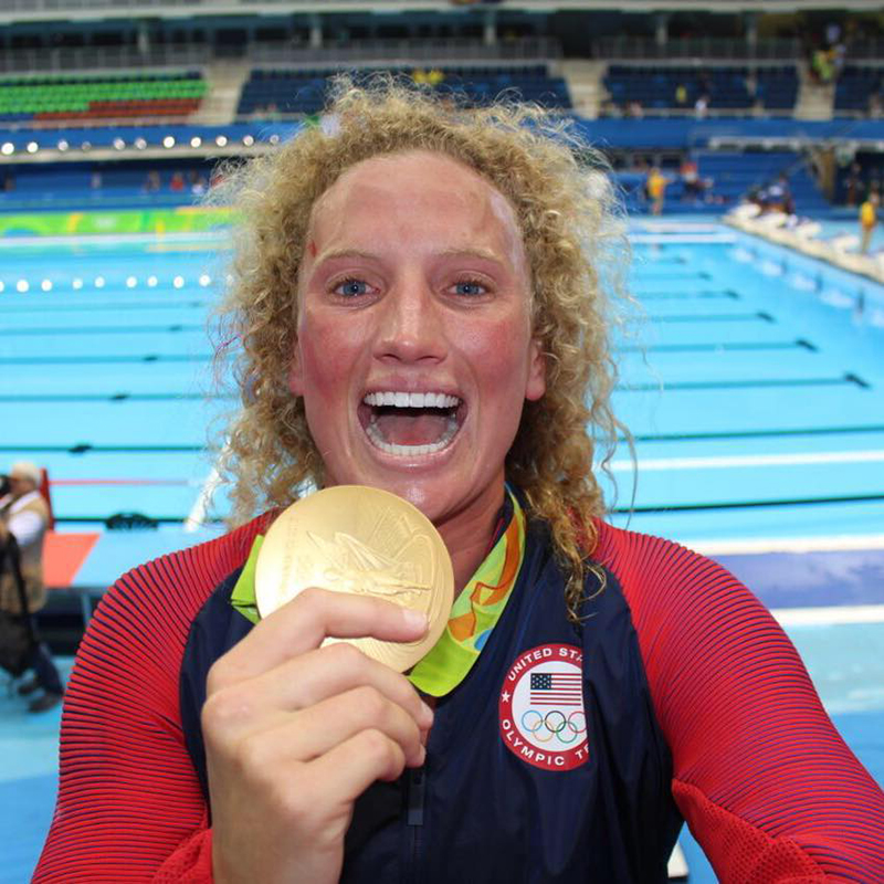 Team USA Water Polo player Kaleigh Gilchrist holding her gold medal