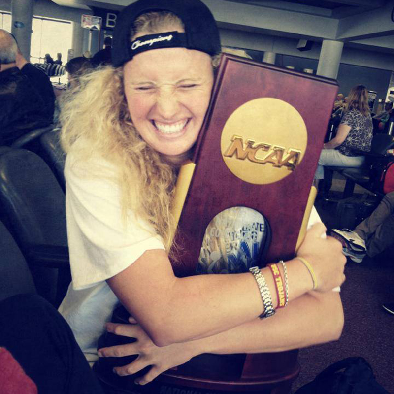 Olympic gold medalist Kaleigh Gilchrist holding her NCAA trophy