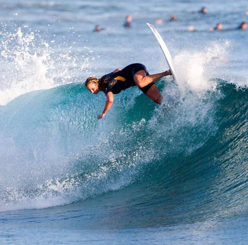 Olympic gold medalist Kaleigh Gilchrist surfing in Newport Beach