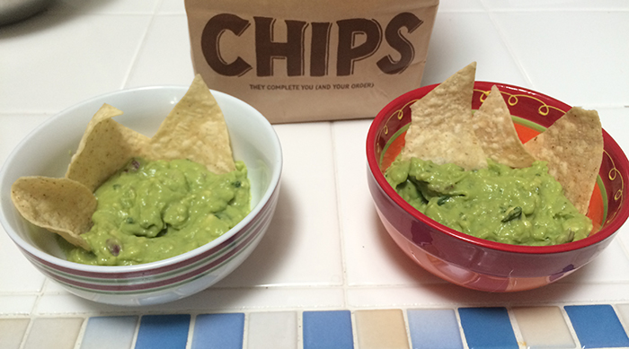 Chipotle's guacamole in a bowl next to a homemade version of their guacamole