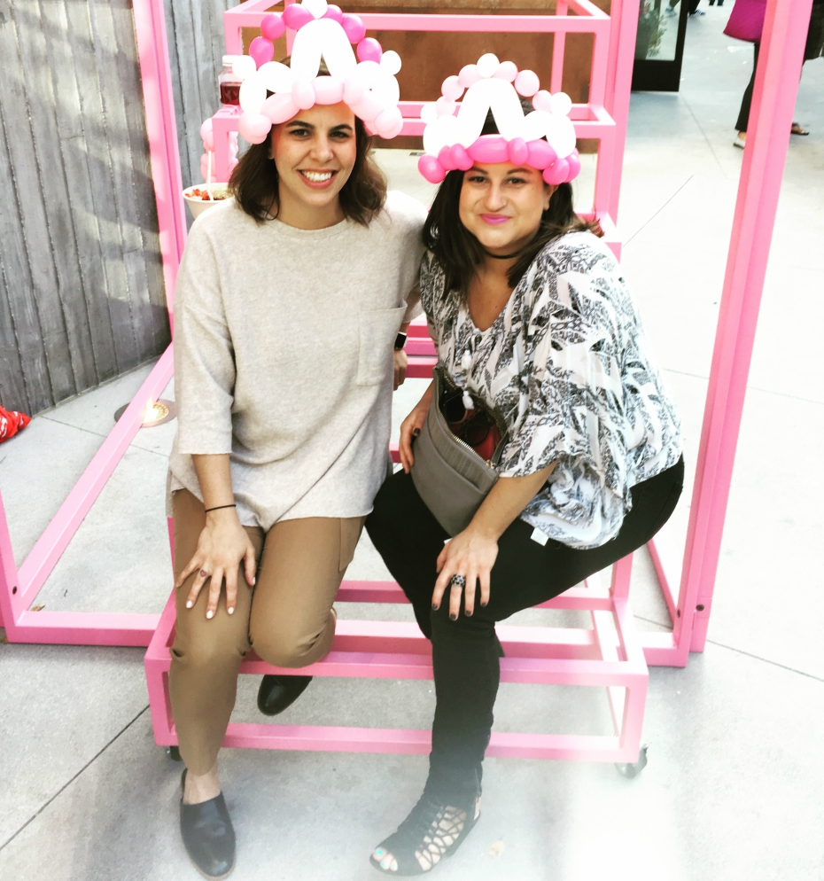two girls wear pink balloon crowns at popxsuki opening