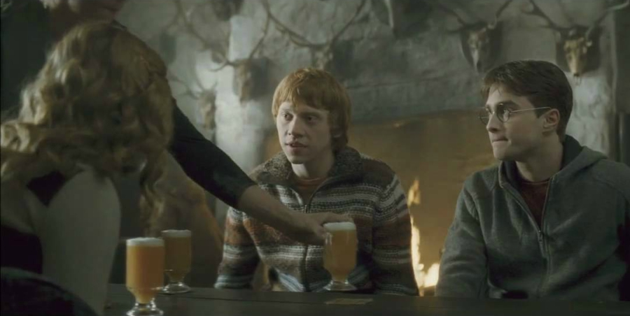 Harry Potter still of Harry, Ron, and Hermione drinking Butterbeer