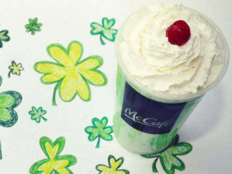 McDonald's Shamrock Shake sitting on shamrock drawings