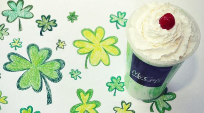McDonald's Shamrock Shake sitting on shamrock drawings