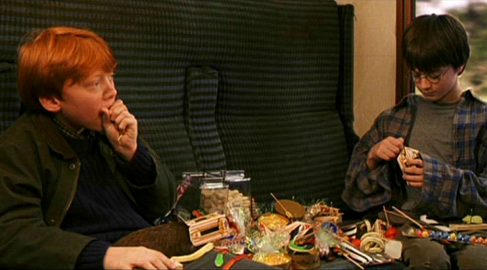 Harry Potter still of Harry and Ron on Hogwarts express eating sweets