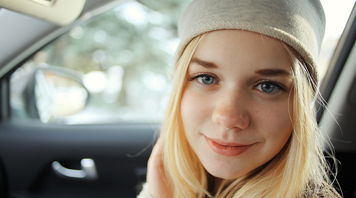 Teen girl smiling and wearing a beanie
