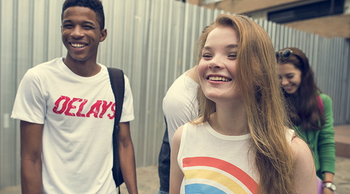 Teen girl and guy talking and laughing