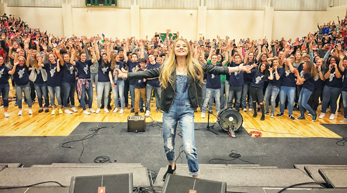 Tegan Marie performing live at Salina South Middle School in Kansas
