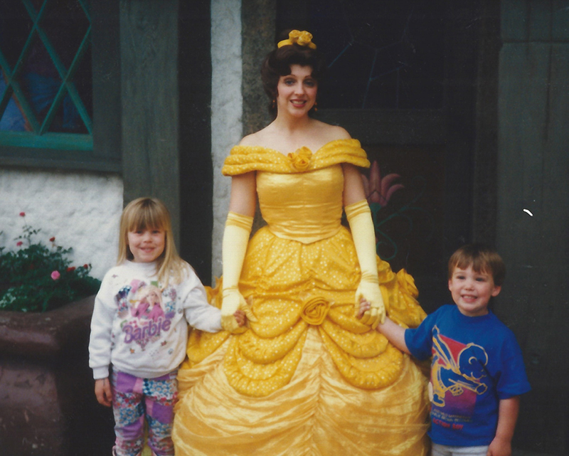 Young girl and boy with Belle lookalike at Disneyland