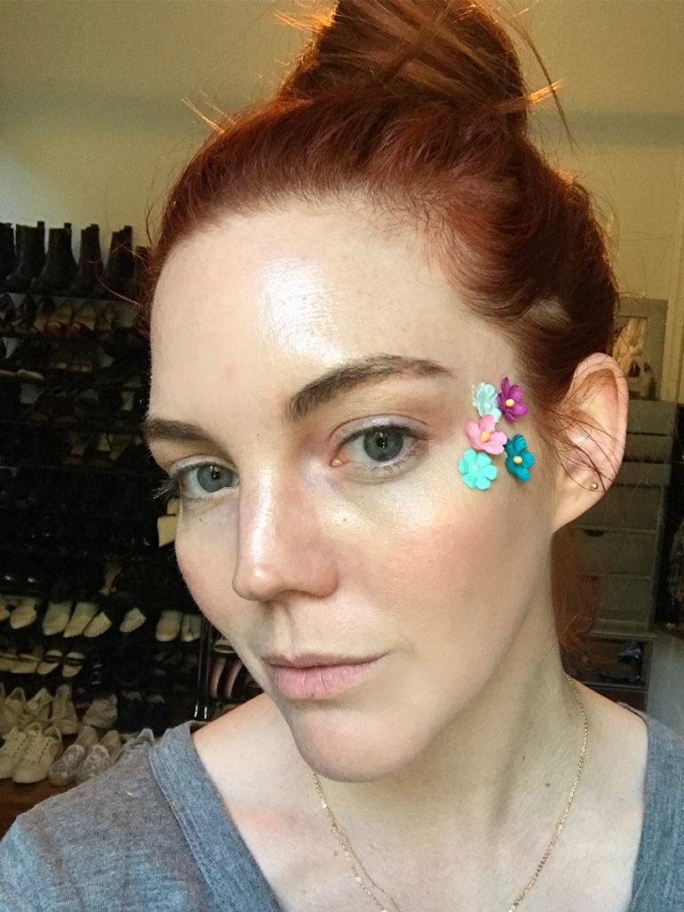 Start adding fabric flowers to face with eyelash glue