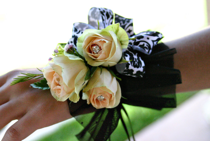 Black, white and yellow corsage
