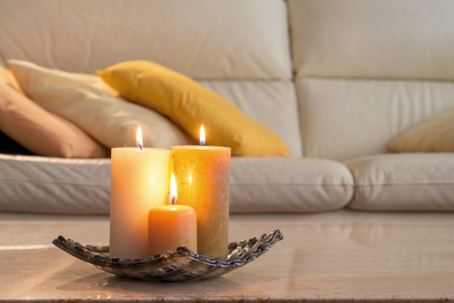 Candles on a coffee table in front of a couch