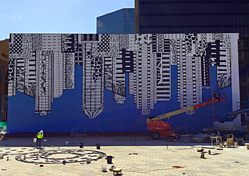 Mural by Kelsey Montague of an upside down cityscape
