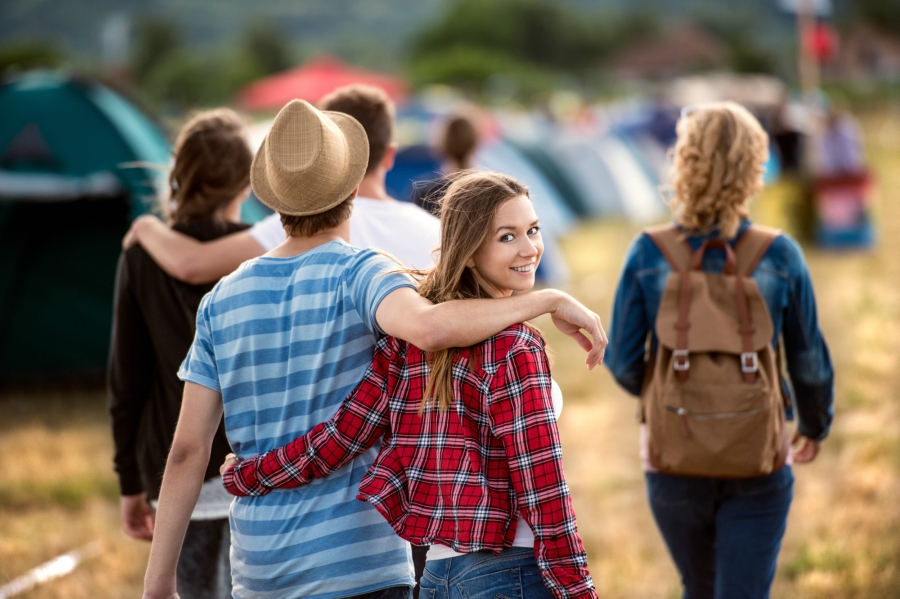 Young couple walking into a music festival