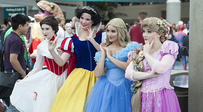 Four women dresses as Disney Princesses
