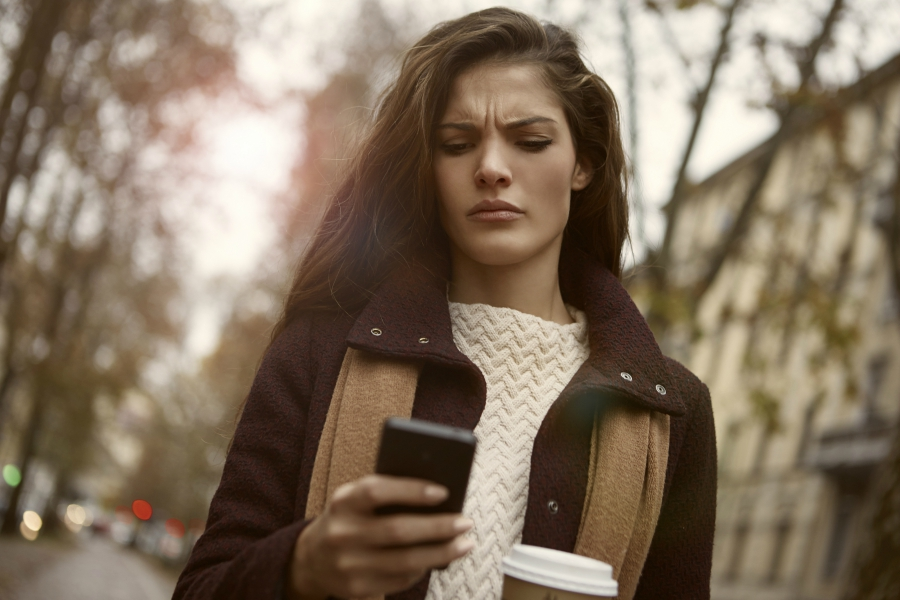 Girl looking mad while texting