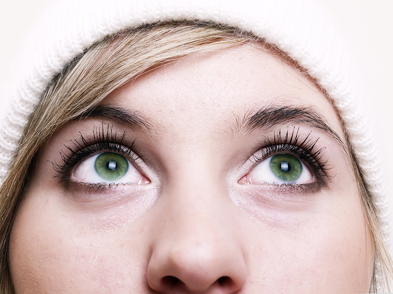 Girl with bright green eyes looking up