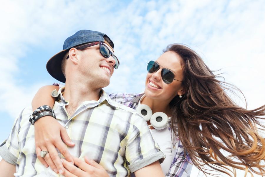 Happy teen couple outside