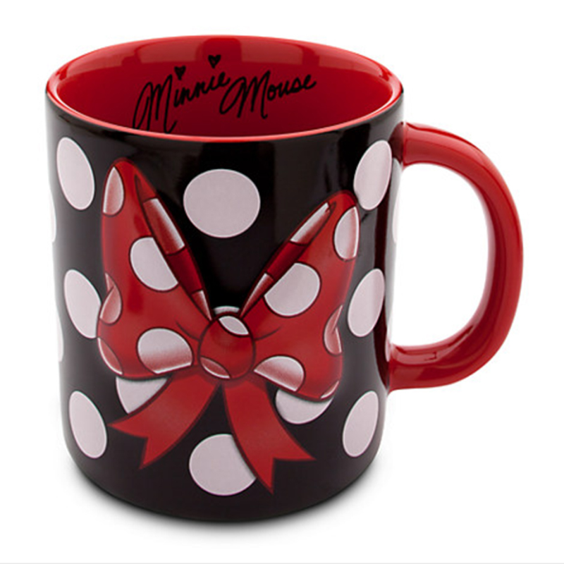 Minnie Mouse-inspired mug with a large bow on the front of it