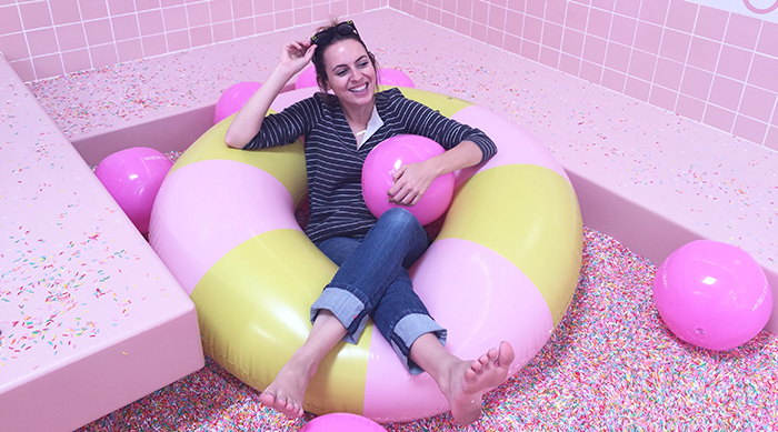 Brittney in the sprinkle pool at The Museum of Ice Cream