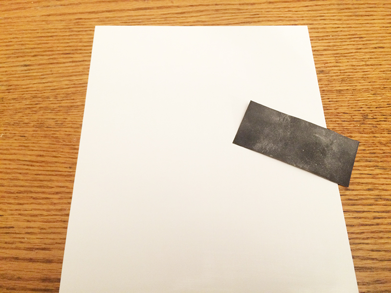 Shrink film paper with sandpaper on top of it