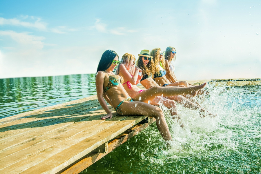 Friends splashing on a dock