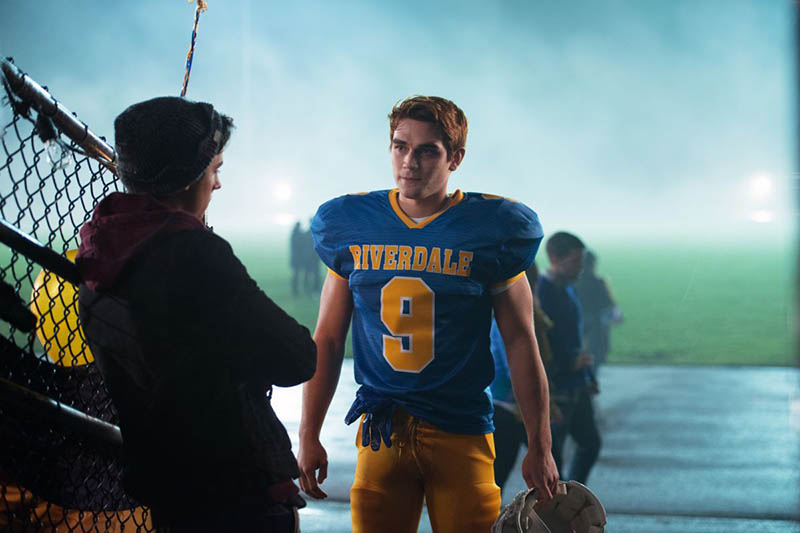 Archie talking to Jughead before a football game in Riverdale
