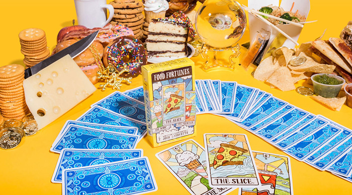 Food Fortunes cards surrounded by foods on a yellow background