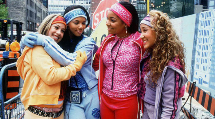 The Cheetah Girls hugging each other after their street performance