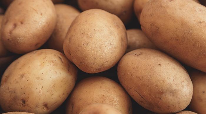 A pile of unpeeled potatoes