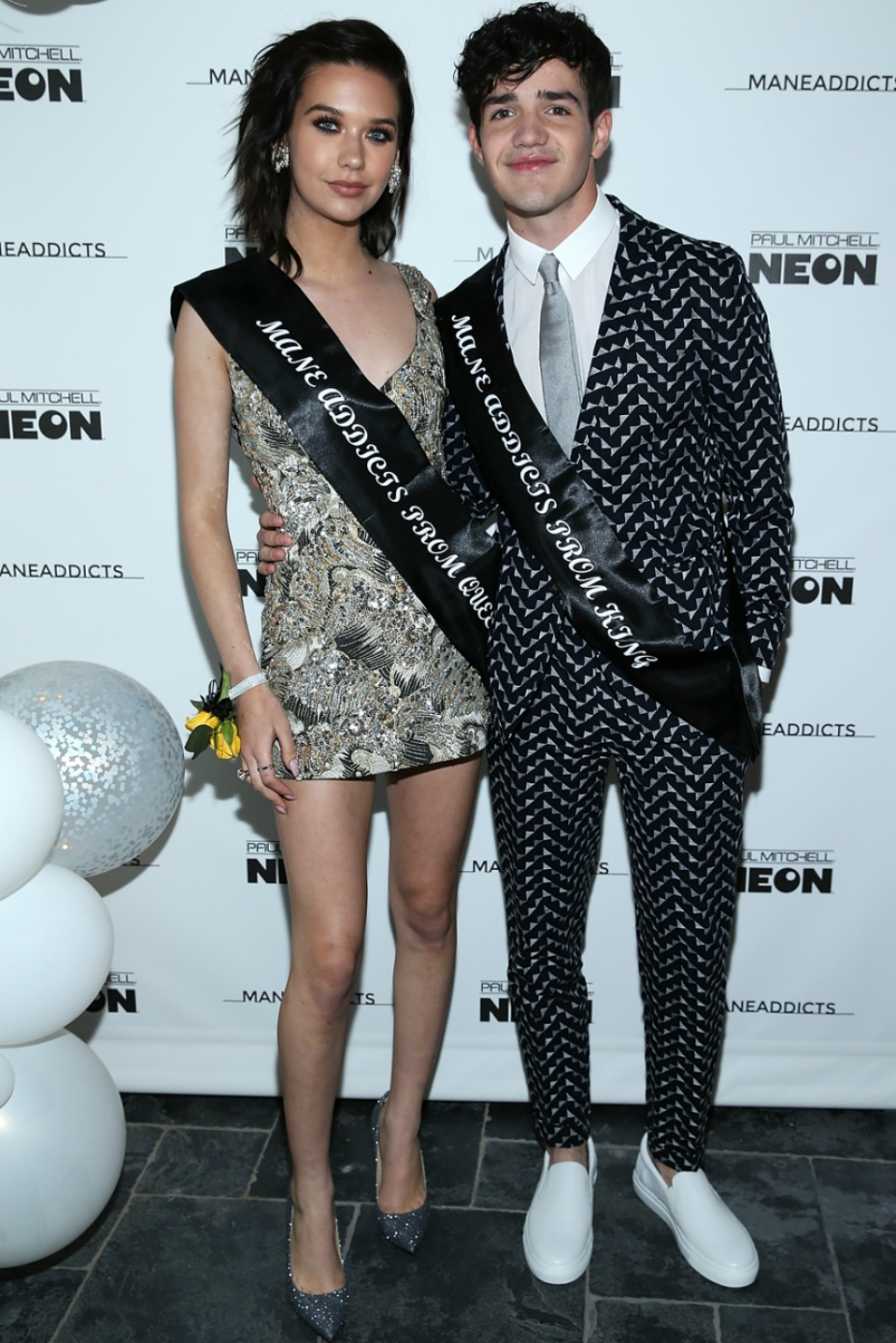 Amanda Steele and Aaron Carpenter pose as prom king and queen during Mane Addicts' Prom '17 party