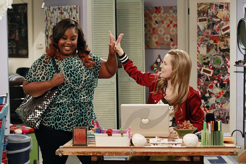 Ivy and Teddy high-fiving each other in Good Luck Charlie
