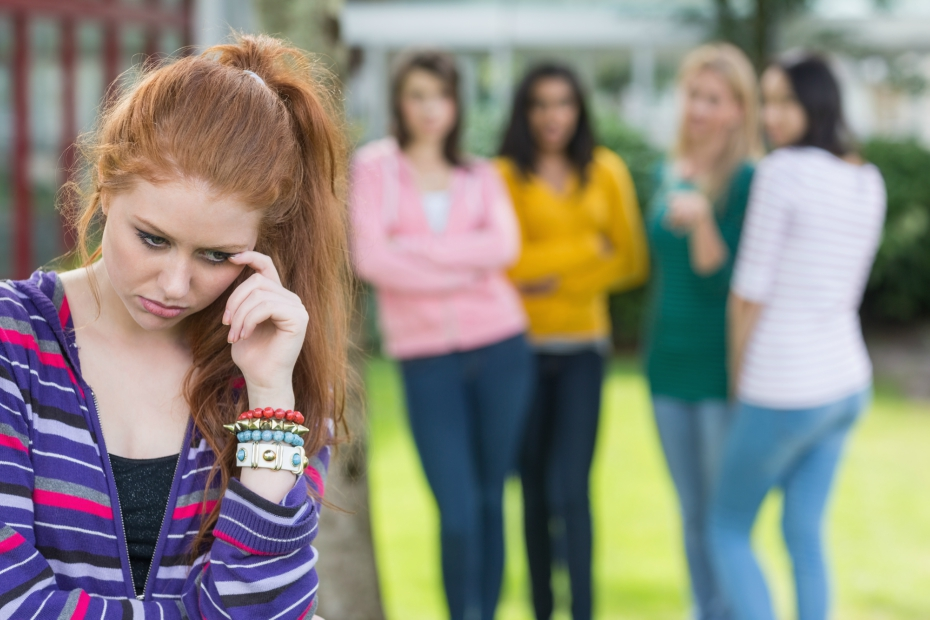 redhead student is bullied by female classmates at school