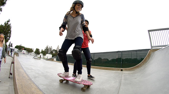 Brittney skateboarding with some assistance