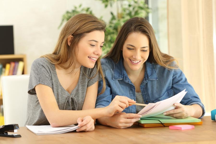 Teen girls doing homework together
