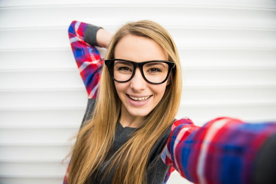 Trendy teen girl wearing glasses
