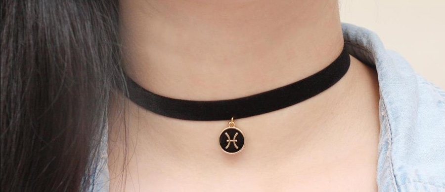 Pisces zodiac sign symbol on a choker
