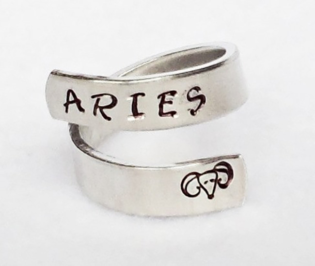 Aries hand-stamped onto a metal ring