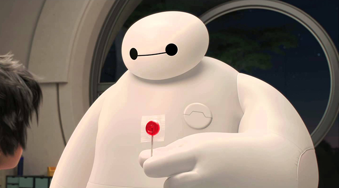 Baymax giving a red sucker to Hiro in Disney's Big Hero 6