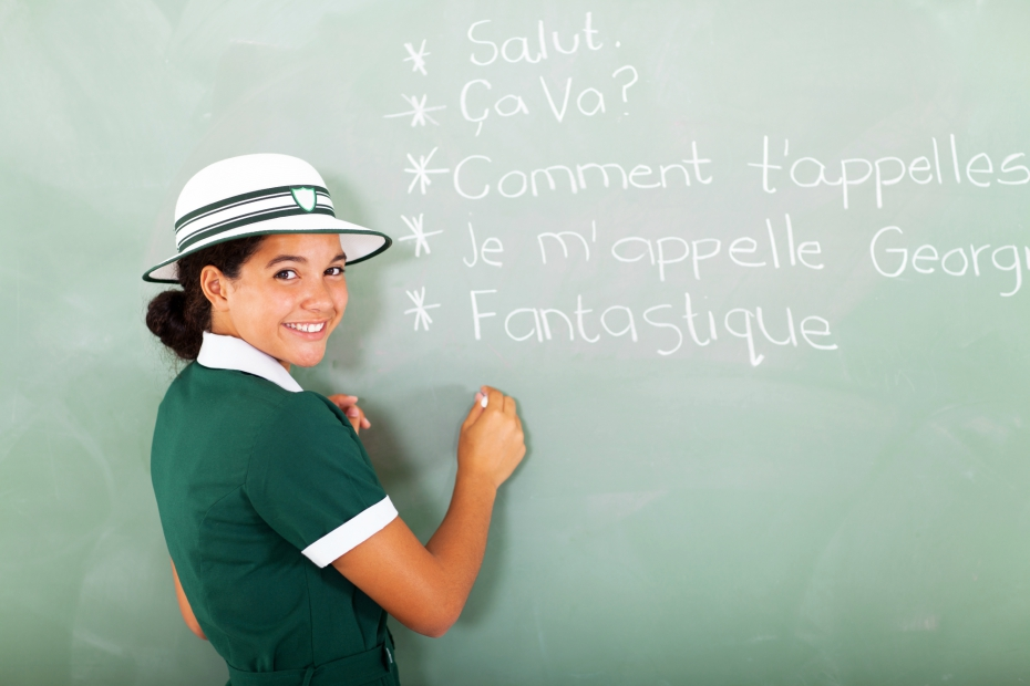 female student practices french in her foreign language class in school